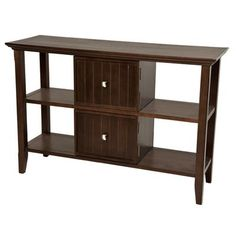 $139.00  The plantation-grown pine is finished with a dark brown tobacco stain and durable lacquer top coat. The Acadian Console Table can be used either in your living room or entrance hallway. Perfect for displaying your family photos, keepsakes, or to store your keys, wallet and documents.
