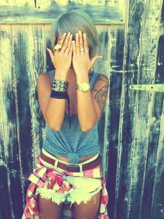 Super cute! Light cut offs, gray tank tied in the front, bright colored flannel. Love it!