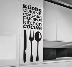 An original sticker combined with 3 pieces of cutlery of this area of the house in 6 different languages.