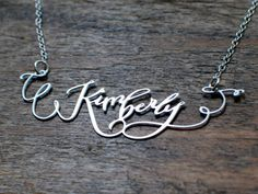 Each custom necklace is hand lettered by calligrapher Crystal Kluge, and then etched into stainless steel.