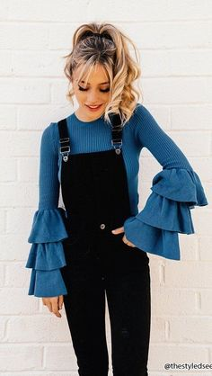 4b22d96ff54921  winter  outfits blue close-neck flounce-sleeve top with black overall pants