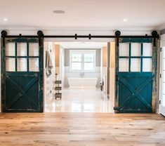 Gorgeous old Barn Doors, repurposed as sliding bathroom doors! Would you like this in your home?