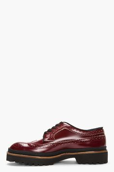 MARNI //  Red leather thick-soled longwing brogues  32379M049001  Low-top leather longwing brogues in red. Round toe with with wingtip detail. Black lace-up closure. Textured trim in black at welt. Black Extralight foam sole. Tonal stitching. Upper: leather. Lining: textile. Sole: synthetic. Made in Italy.  $825 CAD