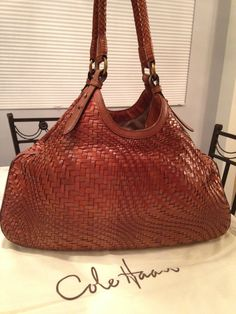 """Cole Haan Genevieve 19"""" Large Woven Leather Weave Triangle Hobo Handbag Saddle Brown Cognac Tote Bag. Get one of the hottest styles of the season! The Cole Haan Genevieve 19"""" Large Woven Leather Weave Triangle Hobo Handbag Saddle Brown Cognac Tote Bag is a top 10 member favorite on Tradesy. Save on yours before they're sold out! GORGEOUS!!! BEAUTIFUL SADDLE BROWN COGNAC COLOR!!! EXCELLENT CONDITION!!! SALE!!! FREE SHIPPING & NO TAX!!! WOW!!!"""