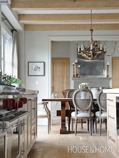 Dine-In Country Kitchen A refined take on country style. Though this Langley, B.C., home is a new build, its interiors have a European farmhouse vibe. Refined pieces like turned-leg dining chairs and an ornate chandelier look rustic rendered in weathered wood. Photo Gallery: Top 10 Eat-In Kitchens | House & Home