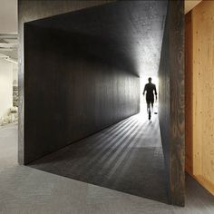 Tunnel to the boardroom -UK headquarters for 18 Feet & Rising - by Studio Octopi