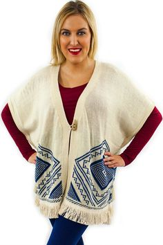 Fringe Knit Poncho - $48.95 - This Fringe Knit Poncho, with crochet detail, is a perfect addition to every ladies wardrobe. The back highlights a beautiful blue diamond knitted pattern on the light colored taupe poncho.  | available at https://www.envyboutique.us/product/fringe-knit-poncho/ |  #Envy #Boutique #fashion #fashiontrends