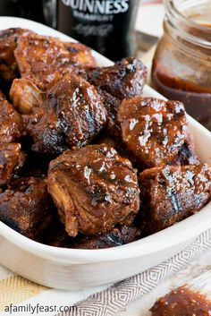 Cook these in the slow cooker before bringing to the grill -Guinness Barbecued Pork Tips - Tender slow-cooked pork tips glazed with Guinness barbecue sauce and grilled until caramelized. Rib Recipes, Entree Recipes, Grilling Recipes, Slow Cooker Recipes, Cooking Recipes, Crockpot Ideas, Filipino Recipes, Guinness, Pork