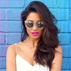 "When Shay Mitchell teamed her flowing side 'do with the perfect lip shade. | 17 Times The Cast Of ""Pretty Little Liars"" Had The Best Hair"