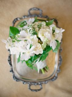 A beautiful white bouquet pairs perfectly with antique silver.