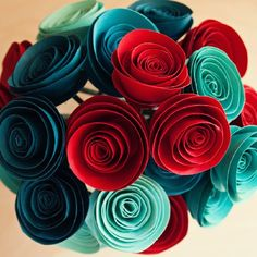 Make these fun paper flowers with any craft paper for a unique piece that won't wilt away and die!