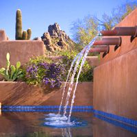 What a whimsical approach to a Southwest swimming pool. Love the tiles and the playful water spouts. By Bianchi Design.