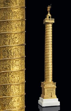 AN ITALIAN GILT-BRONZE MODEL OF TRAJAN'S COLUMN; ROME, CIRCA 1820 Surmounted by a bronze cast by Wilhelm Hopfgarten or Benjamin Jollag. The Prussians preferred to render their models as they appeared in antiquity. Thus, Trajan's Column is topped by Trajan and not St. Peter - Dim: 33 1/2 in. (85.1 cm.) high