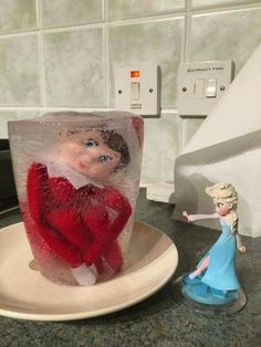 Elsa froze the Elf on the Shelf! Your little Frozen fans would just love this cute Christmas idea!