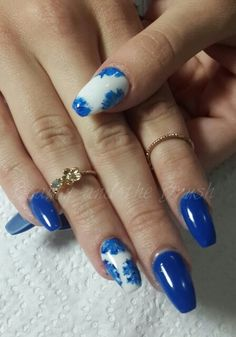 Royal blue coffin shaped nails with white accent nail and hand painted nail art #beautiful #midirings