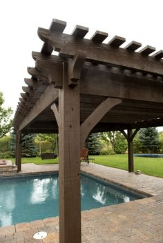 Free standing Western Timber Frame timber frame DIY ShadeScape™ 8000 Series pergola kit installed over swimming pool next to an outdoor. Cedar Pergola, Pergola Canopy, Pergola With Roof, Backyard Pergola, Pergola Shade, Pergola Carport, Gazebo, Pool Shade, Swimming Pools