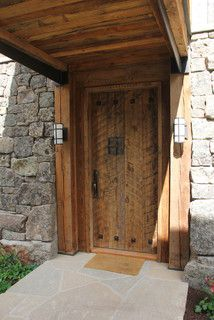 Custom entry door complete with a speak-easy.  Made from reclaimed lumber.  www.reclaimedlumberproducts.com