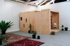 Along with the pods, rugs and plants make the otherwise stark interior homey and informal. Sleeping Pods, Barn Bedrooms, Plywood Design, Plywood Walls, Built In Furniture, Interior Design Boards, Granny Flat, Clothing Storage, Amazing Spaces