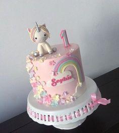 first birthday baby cake unicorn rainbow flowers pink