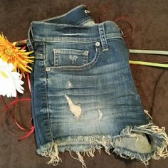 Express jean shorts NWOT NWOT Freaking adorable very distressed cut off jean shorts in size 4. I never got to wear them, tried them on, took the tags off, put them away and forgot about them... they are too cute to be forgotten. The poshmark photo app shows weird shadows...almost look stained... assuredly, they are not stained in any way. Express Shorts Jean Shorts