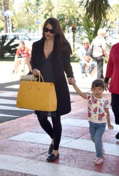 Aishwarya Rai Bachchan at the Nice airport with her two-and-half-year old daughter Aaradhya. #Style #Bollywood #Fashion #Beauty #Cannes2014