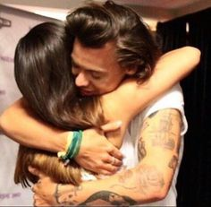 """""""When harry hugs fans he whispers cute things in their ear"""" I think I'm gonna cry he's so perfect"""