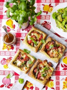 Vegetable tartlets | Jamie Oliver  Ingredients 1 x 500gblock of ready-made puff pastry plain flour, for dusting 4teaspoonspesto 1handful ofmixed, ripe cherry tomatoes 8asparagus spears 4baby courgettes 2-3jarred roasted peppers ½a bunch offresh basil olive oil 8black olives, optional 1 x 100gball mozzarella 20gParmesan cheese, optional  Read more at http://www.jamieoliver.com/recipes/vegetables-recipes/vegetable-tartlets/#o1JMs7ty8igBijBC.99