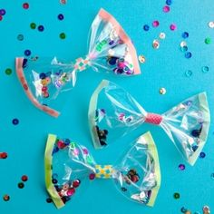 Decorate gifts with homemade confetti bows (via Omiyage)