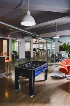 A gut reno transforms this full floor loft into a cohesive, fun and efficient work space. Arcade games, custom signage and glass walls contribute to the office's very custom design.