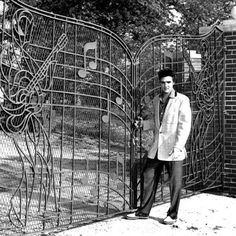 Elvis poses with the iconic gates in 1957. (Graceland - Memphis )