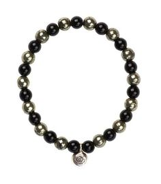 Evil Eye Protection Bracelet House of Shakti. $45.00. Obsidian and Pyrite Beads with Karen Hill Tribe Silver Evil Eye Charm. For protection. Handcrafted in Beverly Hills, CA. measures 7""