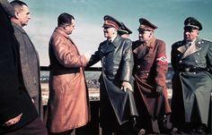 Hitler and Martin Bormann (far right), 1942.