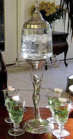 Art Deco Lady Absinthe Fountain with matching glasses and spoon.