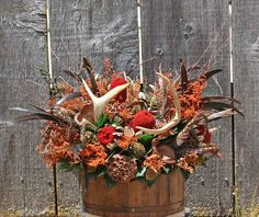 deer horn flower arrangements | The Pheasant Antler Bucket is filled with antlers, pods, pheasant ...