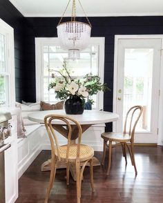 [New] The 10 Best Home Decor (with Pictures) - This little dining nook has stopped me in my tracks so many times! I love the dark walls mixed with the wood chairs and gorgeous blooms // design by Küchen Design, House Design, Style Me Pretty Living, Banquette Seating, Dining Room Inspiration, Design Inspiration, Kitchen Nook, Kitchen Reno, Kitchen Ideas