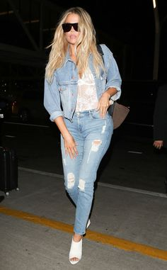 The E! star pairs a sexy top withdestructed denim during her outbound flight from LAX to Paris.