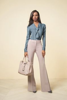 Add color to neutral basics with a blouse. Add a jacket for a business professional look.