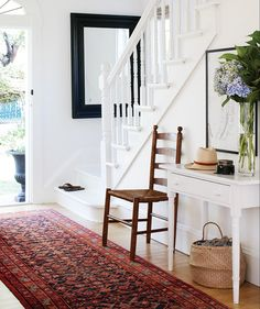 Get a fresh spin on your classic entryway console table! Discover fresh alternatives to popular design trends in our online series, Updated Classics. Foyer Furniture, Entryway Console Table, Entryway Stairs, Modern Entryway, Furniture Design, Benjamin Moore Cloud White, Most Popular Paint Colors, White Staircase, Staircase Diy