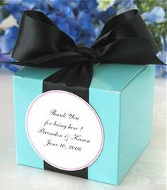 """Aqua Blue 3.5""""L x 3.5""""W x 3""""H gift box wrapped on 2 sides with 1 1/2"""" wide Black double-faced satin ribbon, with a Large, Round gift tag in ..."""