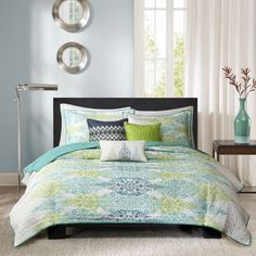 This attractive Mali quilted set will elevate the comfort of your bedroom and provide an ethnic feel. Color tones of blue, teal and green give the patterns a light and clean feel that will purify your sleep time.