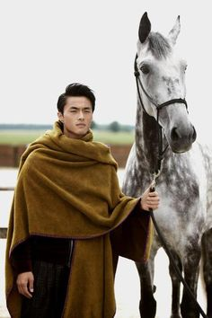 """Model Zhao Lei is photographed by Anaëlle Le Roy and styled by Bianca Tisserand in the story """"A Gentle Man"""" for Elle Vietnam. Zhao Lei by Anaëlle Le Roy Character Inspiration, Character Design, Writing Inspiration, Fashion Inspiration, Kenzo, Mens Poncho, Grandeur Nature, Man On Horse, Poncho Knitting Patterns"""