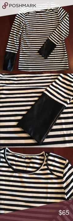 Striped leather cuffed shirt Black and white striped long sleeve top with black faux leather at the ends of the sleeves and pretty shoulder detail shown in 3rd photo.  Only worn for photos :) make offer! Tops