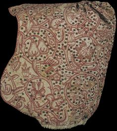 """Coif: 1600-1625, English, linen, silk thread. """"This coif is a fine example of blackwork, a style of needlework popular in England in the late 16th and early 17th centuries. It was worked with a single colour of silk, usually black, but also blue, green or, as in this coif, red on linen. Like other embroidered dress accessories, the needlework on this coif is highlighted with silver-gilt spangles..."""""""