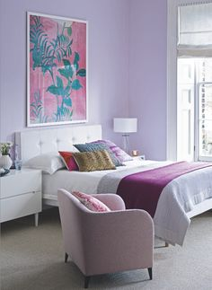 Pretty lilac bedroom. Like the color scheme.