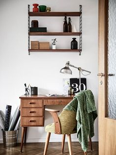 Teak furniture, bold patterns, and vintage knickknacks... A mid-century vibe with a contemporary look!