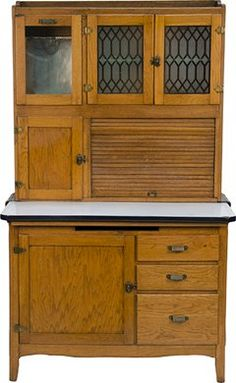 Oak Hoosier Cabinet. We had one almost exactly like this in our old house. We used to fill it with everything mom told us to put away.