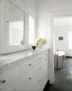 White carrara marble counter green slate floor white cabiry and contemporary bathroom accessories sets contemporary bathroom sink Contemporary Bathroom Accessories, Contemporary Bathroom Sinks, Marble Bathrooms, White Counter Stools, White Counters, Marble Countertops, White Cabinets, Tv In Bathroom, Bathroom Renos