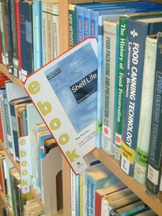 """Holbeach e-book marker [old photo],"" by Paul Stainthorp, via Flickr -- ""Plastic shelf marker used to advertise the presence of an e-book. Holbeach Campus Library, University of Lincoln, Holbeach, Lincolnshire. 1 May, 2009"" -- [NOTE: I can no longer find this product at the source listed at the click-through. DIY time.] Was going to put this on my ""Librarianship"" board, but I think I might do this for my home library shelves!!"