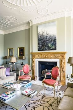 Green walls, modern furniture & art - Living Room Design Ideas (houseandgarden.co.uk)