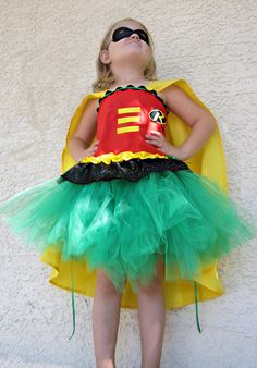 Superhero tutu costume for girls corset top and mask included. $60.00, via Etsy.